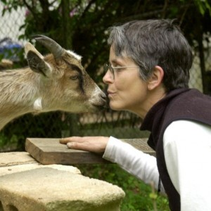 Sally kissing a goat